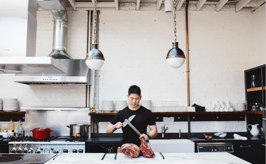 Erik Sun cutting meat