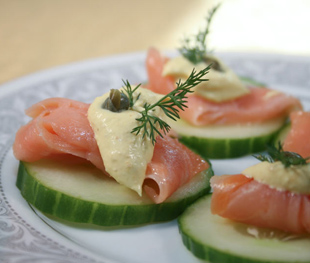 Cucumber slices topped with wild salmon, organic sour cream and capers